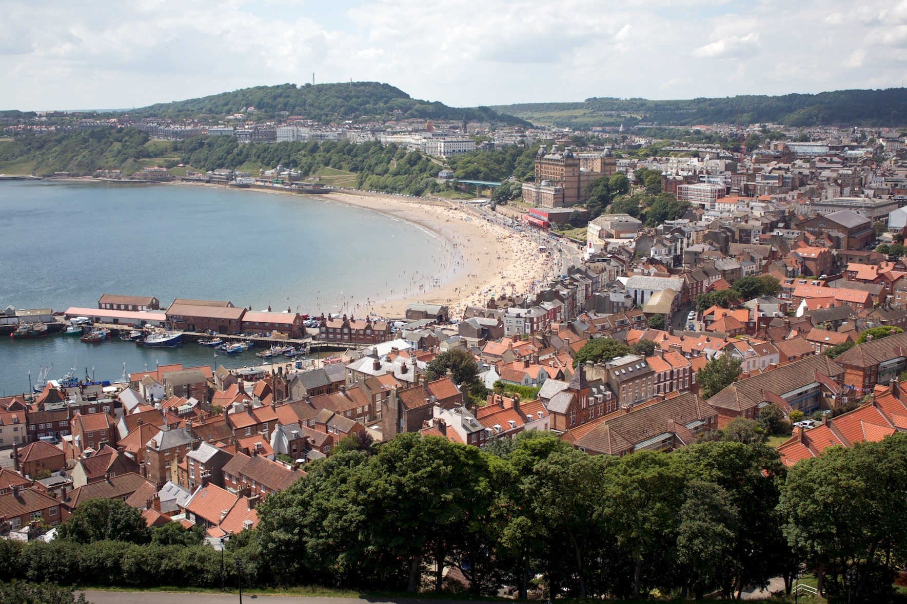 scarborough Scarborough (/ ˈ s k ɑːr b ər ə /) is a town on the north sea coast of north yorkshire, england historically part of the north riding of yorkshire, the town lies between 10-230 feet (3-70 m) above sea level, rising steeply northward and westward from the harbour on to limestone cliffs.